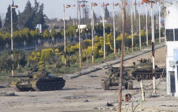 879963_syrian-tanks-are-seen-in-bab-amro-near-the-city-of-hom