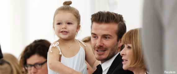 Former England soccer captain David Beckham holds his daughter Harper as he speaks to Vogue editor Anna Wintour while waiting for a presentation of the Victoria Beckham Spring/Summer 2014 collection during New York Fashion Week
